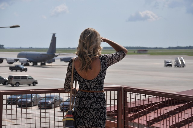Woman watching plane